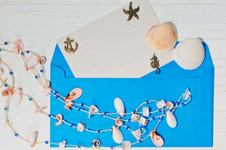 coulomb: Concept with holidaymakers letter in blue envelope and different sea shells Stock Photo