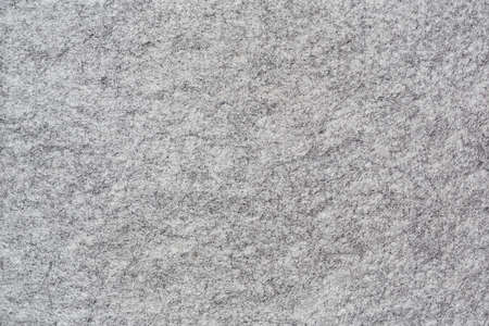 Horizontal background of soft grey felt with genuine texture