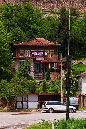 VELIKO TARNOVO, BULGARIA - MAY 28, 2017: Traditional bulgarian house just down the fortress hill on secondary lane