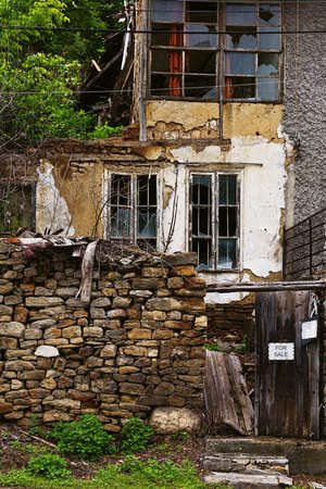 Obsolete house abandoned by his owners on secondary street in Veliko Tarnovo, provincila center of Bulgaria
