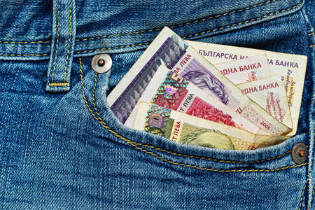 Bulgarian national money in front worn jeans pocket - poverty and crisis symbol concept Stock Photo
