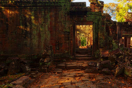 SIEM REAP, CAMBODIA - DECEMBER 31, 2016: Ruins of ancient temple of Angkor complex in sunset
