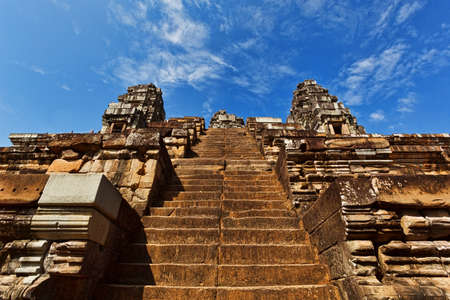 SIEM REAP, CAMBODIA - DECEMBER 29, 2016: Ascent to the top of hinduism temple in Angkor ancient complex Editorial