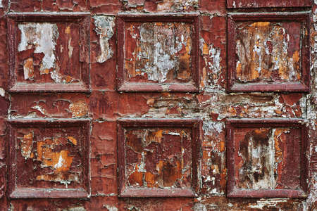 grungy: Old and weathered, very damaged gate or wall panel texture background with traces of old brown paint