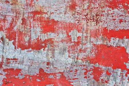 Horizontal metal texture, very damaged because of wearout and mechanical damage. Traces of red paint. Scratches and scrapes, corrosion traces. Close-up capture.