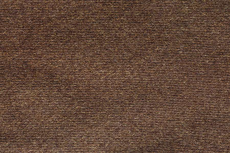 Horizontal background of dense and rough wool fabric texture similar to felt and drap. This kind of fabric usable for coat and overcoat making. Cloth is very textured and has brown color. Standard-Bild