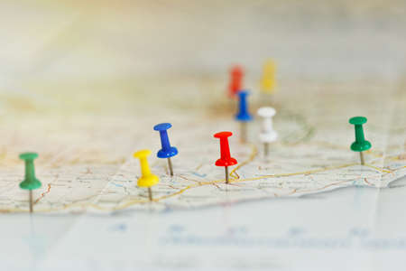 Map of a sea shore with route highlights and places of interest marked by colored pins. Vacations preparations idea, route planning concept. Close-up capture, selective focus, unrecognizable names.