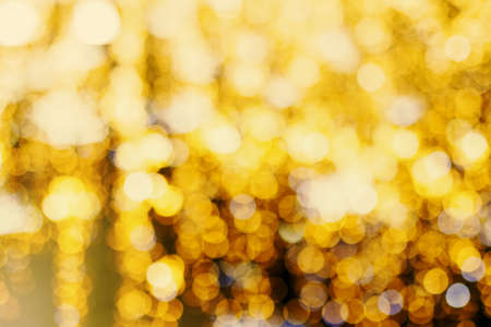 Out of focus area yellow lights - image effect calling bokeh. Usable as background. Soft focus. Reklamní fotografie