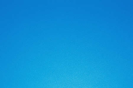 Blue plastic background with gradient paint and dotty texture. Horizontal close-up capture.