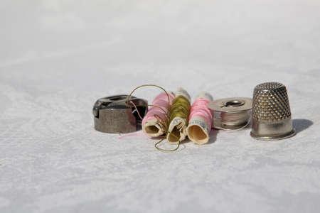 sewing cotton and thimble Фото со стока