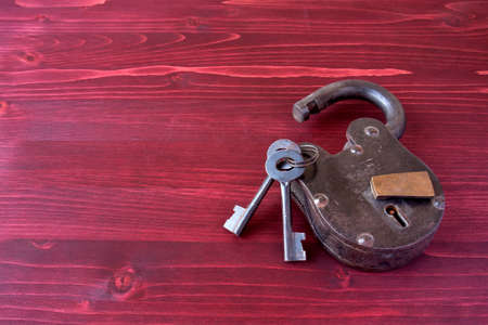 lock symbol: Old Fashioned Lock and Keys on a Red Wooden Background