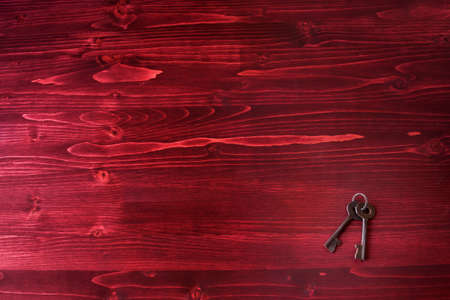 lock symbol: Old Fashioned Keys on a Red Wooden Background Stock Photo