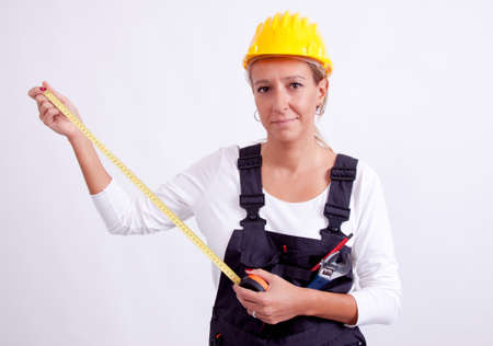 female construction worker: Female construction worker with tools on white  Stock Photo
