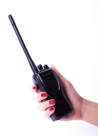 transmitter: Female hand holding portable radio transmitter, isolated over white background