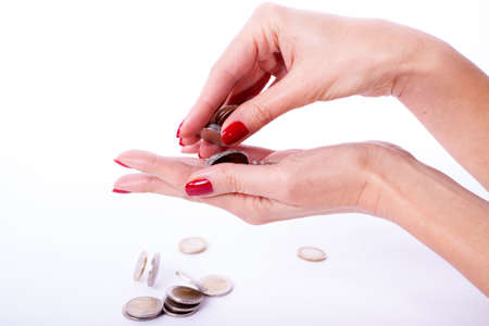 Woman hand showing an euro coin isolated on a white background photo