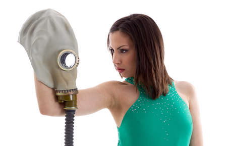 Girl in a green dress with gas mask
