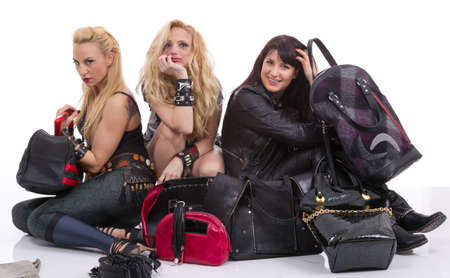exultant: A group of happy girls having fun with leather handbags
