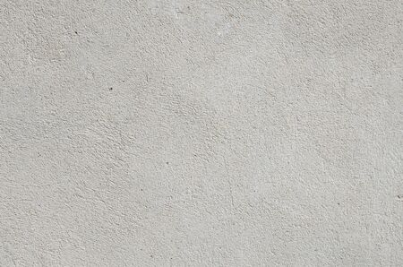 Background texture of an old white concrete wall. Texture. Archivio Fotografico