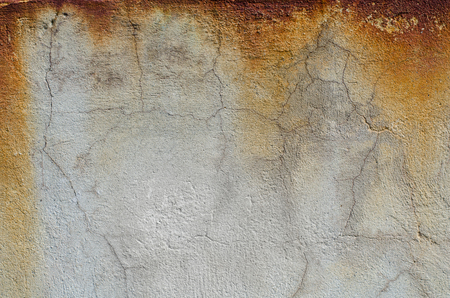 Rust on the gray concrete wall. Texture.