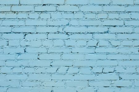 Texture of an old light blue brick wall. Banque d'images