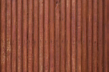 Fragment of the old brown colored wooden door with small nails. Texture. Archivio Fotografico
