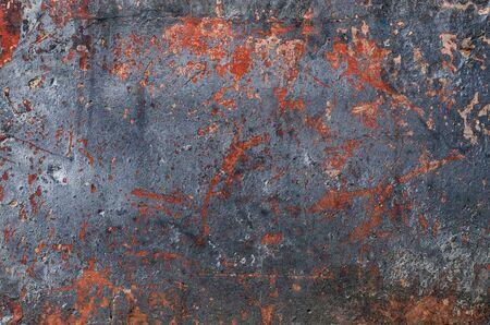 Multi-colored texture on the concrete surface. Rusty orange spots. Black metallic. Banque d'images