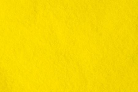 Fragment of yellow cloth Microfiber. Pile texture. Background image. Archivio Fotografico