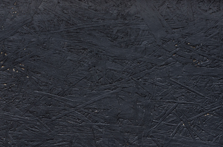 Black chipboard also called particleboard. Background texture. Banque d'images