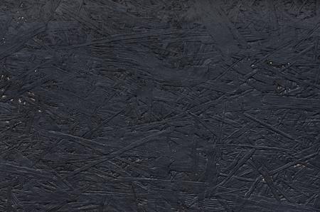 Black chipboard also called particleboard. Background texture. Archivio Fotografico
