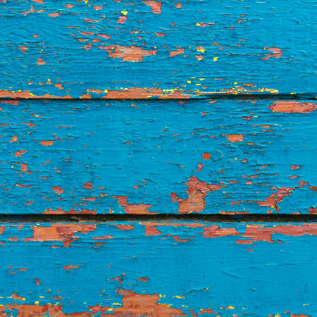 Peeled wooden boards. Blue color. Texture. Cracked paint.