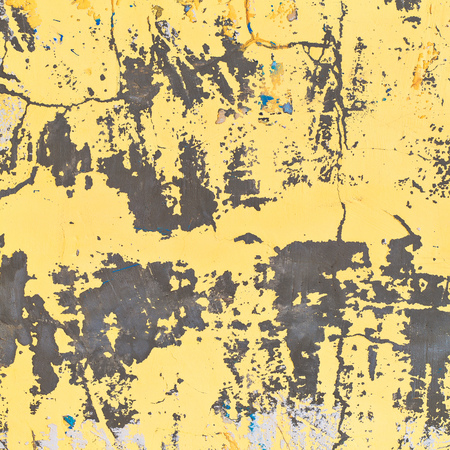 Background texture of a yellow colored old wall. Weathered surface.