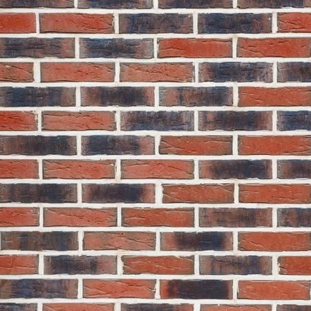 Texture of a brick wall. New bricks of different shade. Archivio Fotografico