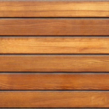 Wooden surface is brown color. Smooth texture.