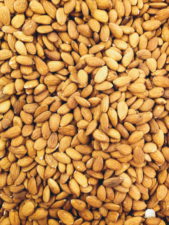 Closeup of whole almond nuts for background. Banque d'images