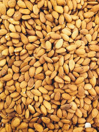 Closeup of whole almond nuts for background. Archivio Fotografico