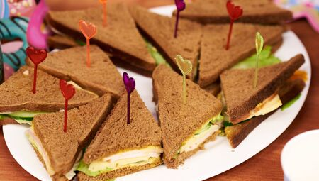 Triple decker toasted sandwich on plate a cafe party