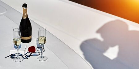 Romantic date surprise. shadow of kissing young guy and a girl on yacht.