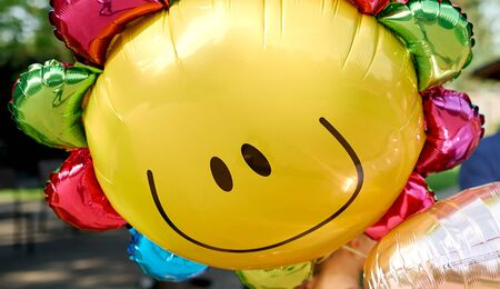 Yellow balloon with smile look like sunny