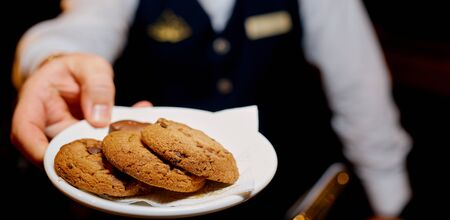 man water holding bowl with delicious cookies, closeup. High quality photo Archivio Fotografico