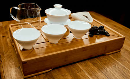 Chinese traditional tea tray with dragon on tray and empty kettle cups