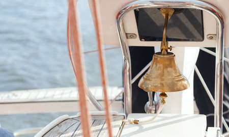 Bell on sailing ship.