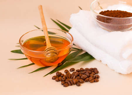 Spa care at home. Scrub of coffee and honey. Light background. Space for text. Horizontal photo. The view from the top.