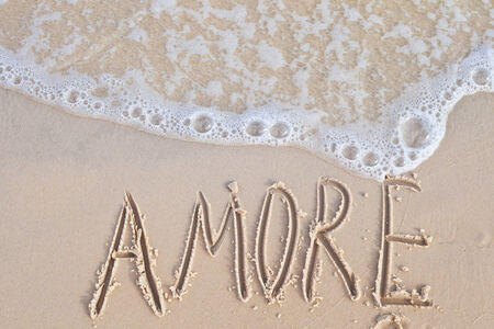 amore: Writing amore at the beach Stock Photo