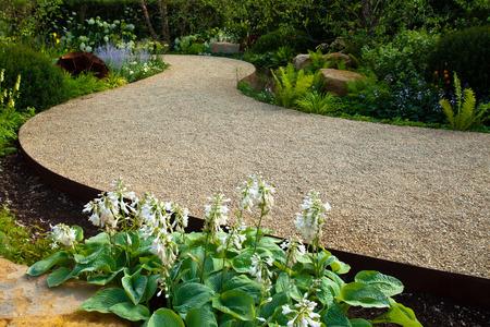 Tranquil garden landscape with a garden path Standard-Bild