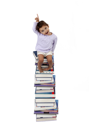 seating: Young girl seating on books Stock Photo