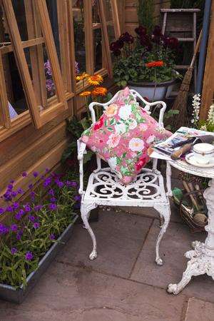 herbera: Metal decorative chair in a garden Stock Photo