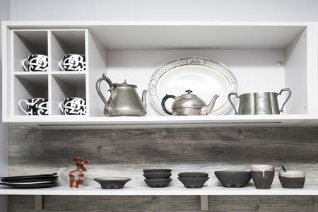 domesticity: Kitchen shelf with dishes Stock Photo
