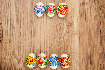 Decorated Easter eggs on wooden background Standard-Bild