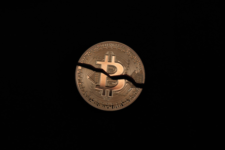 Cracked on two pieces bitcoin coin isolated on black background Standard-Bild
