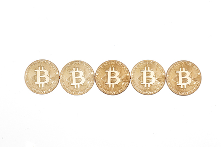 Five bitcoins coins in line isolated on white background